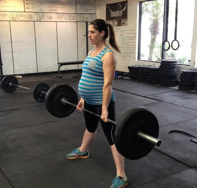 How Can I Keep Lifting Weights While Pregnant?