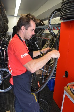 Team mechanic gluing up new tires