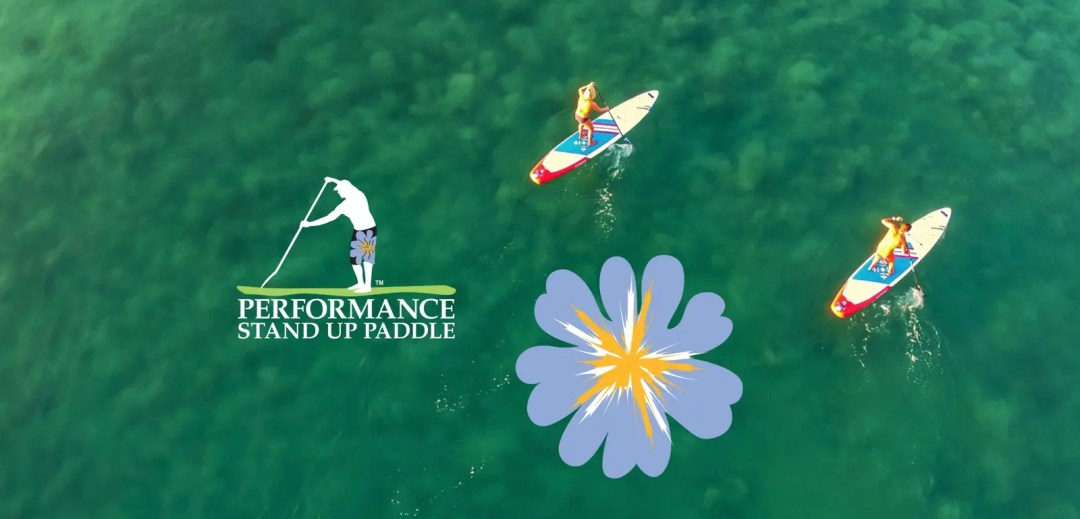 Shane and Mia from above paddling their SUPs in the ocean off Punta de Mita, Mexico