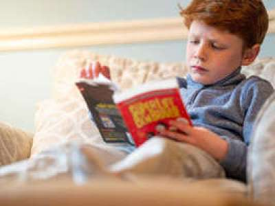 Michael's tutor has introduced some fun book titles to read on his own, which has made him see reading as less of a chore and more of a pleasure.