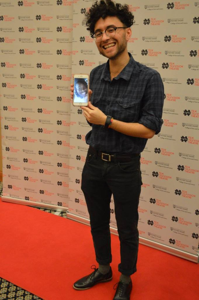 Student with smart phone at Notre Dame Student Film Festival