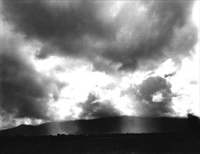 I remember sleeping on my Aunt's veranda and being woken by heavy drops of rain. Dimbulah was hot and dry, but Cairns on the coast was hot and humid, and when it rained it just poured down. The clouds were so low I felt I could touch them.