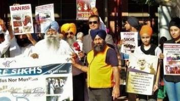 Sikh community members in Sydney protesting against Modi