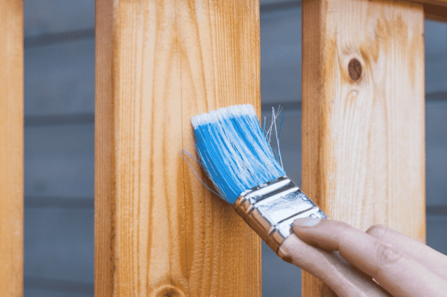 Brush slanted on a piece of wood.