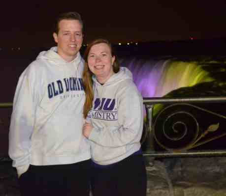 Casey and Mr. PC in front of Niagara Falls at night