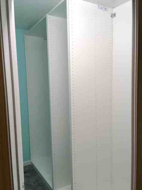 open wardrobes lined up in closet