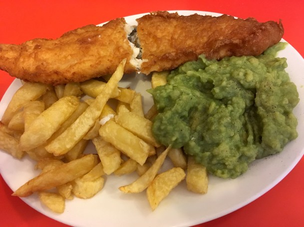 fried fish, chips, and mushy peas