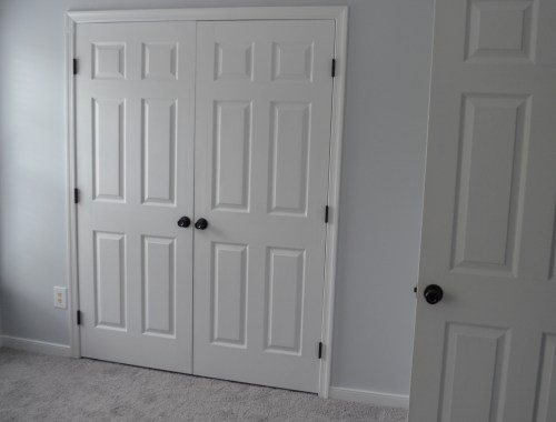 guest room with painted hinges and knobs