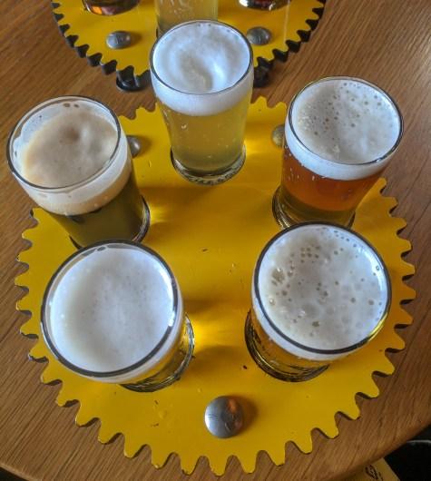 a beer flight at Crank Arm Brewing