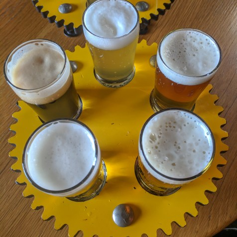 a beer flight at Crank Arm Brewing