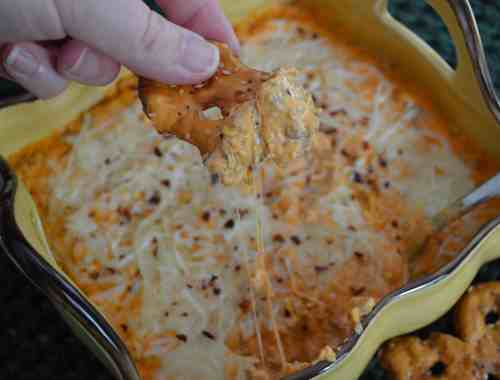 Pizza dip goes great with salty pretzel crisps.
