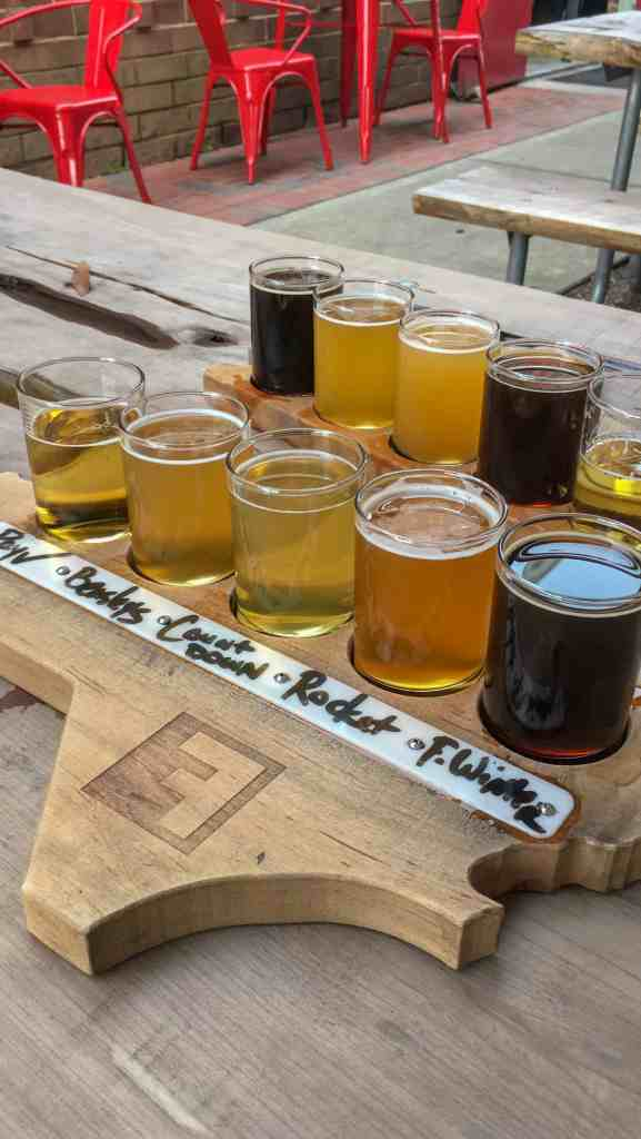 A flight of craft beer from Fullsteam Brewing comes on an NC shaped board.