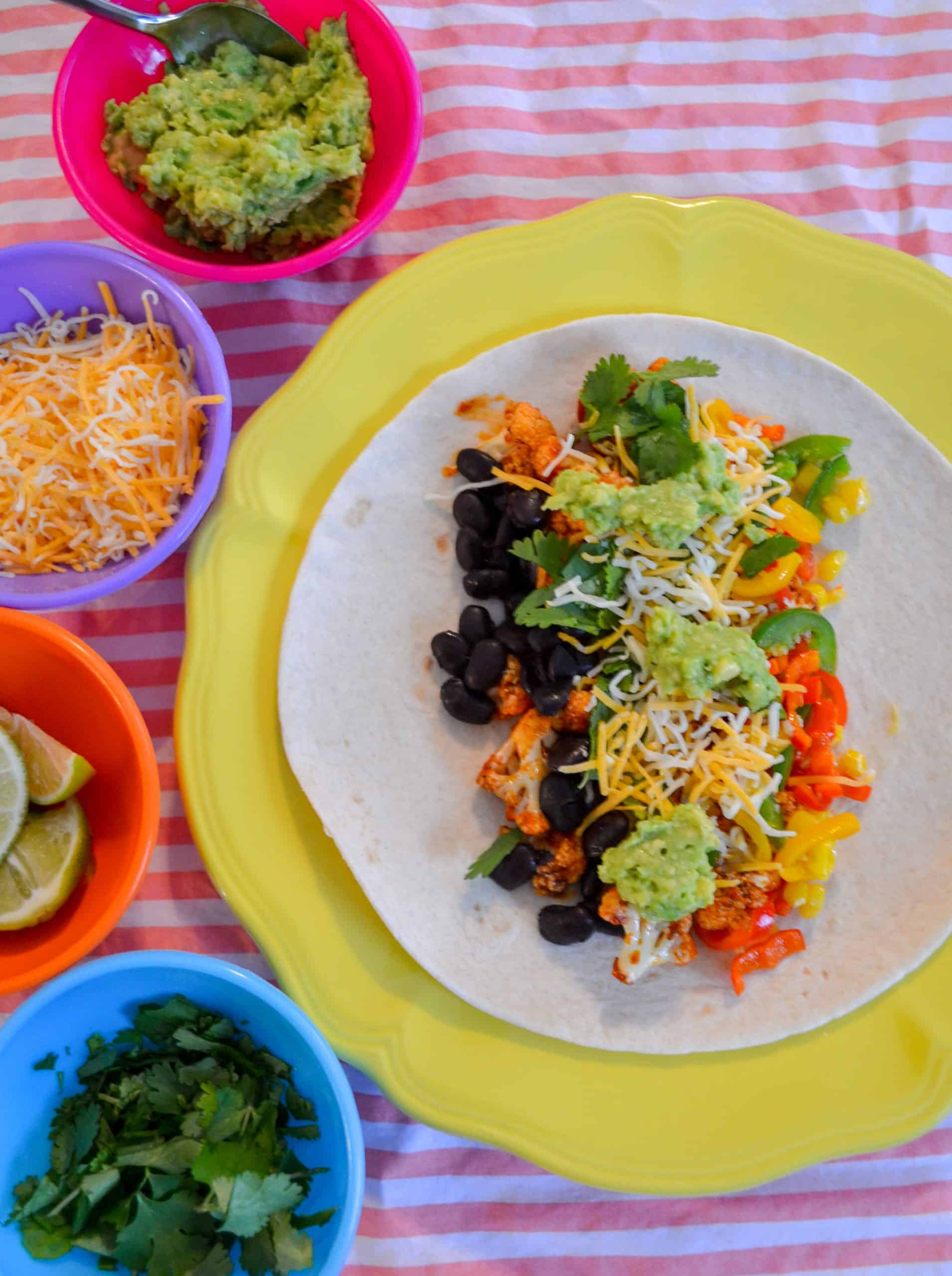 roasted cauliflower and black beans are healthy burritos