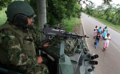 A Colombian soldier stands guard on an armored tank overlooking a road near Corinto, Cauca province May 28, 2010. Security tightens in Colombia as the country prepares for the first round of its presidential elections, which will be held on May 30. REUTERS/Jaime Saldarriaga (COLOMBIA - Tags: POLITICS ELECTIONS MILITARY IMAGES OF THE DAY)