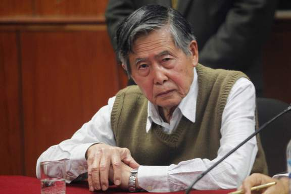 Peru's former President Alberto Fujimori listens to the judge's verdict about his sentence in prison, in Lima October 29, 2013. The Supreme Court of Justice denied today Fujimori's request to serve his sentence under house arrest. Fujimori was sentenced in April 2009 to 25 years in prison for ordering death squads to carry out two massacres when his government was hunting down presumed leftist insurgents. Another trial convicted him of corruption and abuse of power. REUTERS/Enrique Castro-Mendivil (PERU - Tags: CRIME LAW POLITICS)