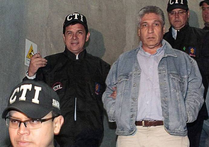 FILE - In this Wednesday, May 16, 2012 file photo, released by Colombia's Prosecutor's Press Office, Sigifredo Lopez, a former provincial lawmaker, right, is escorted by members of the prosecutor's office after his detention in Bogota, Colombia Authorities arrested Lopez for allegedly telling leftist rebels in detail how to kidnap his fellow lawmakers. Lopez was among legislators the insurgents seized in the 2002 raid in Cali. All of the 11 other lawmakers were executed by the rebels five years later under circumstances that remain unclear. Now in prison, Lopez on Monday, May 28, 2012, vowed his innocence and said he was the victim of a miscarriage of justice. (AP Photo/Prosecutors Press Office, File)