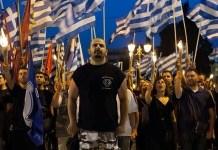 Policías griegos tienen vínculos con el partido de extrema derecha, Amanecer Dorado, en Grecia. © STR/AFP Getty Images