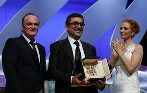 Quentin Tarantino, Nuri Bilge Ceylan y Uma Thurman © AFP / V. Hache