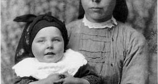Luis Ksado. Mujer con niño en brazos
