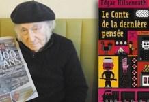 Edgar Hilsenrath junto a un periódico que recuerda el Centenario del Genocidio Armenio y la edición de su obra en francés que aborda el tema.