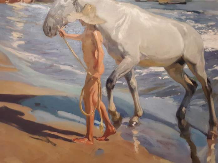 Sorolla: niño y caballo en la playa