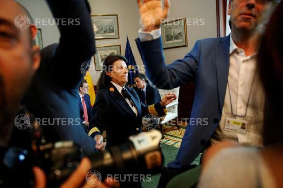 Members of the media are escorted out as Spain's acting Prime Minister Mariano Rajoy (L) and Spain's Socialist Party (PSOE) leader Pedro Sanchez sit before their meeting at Spanish parliament in Madrid, Spain August 2, 2016. REUTERS/Susana Vera