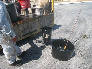 Hot Bitumen is applied to cold joint edges.