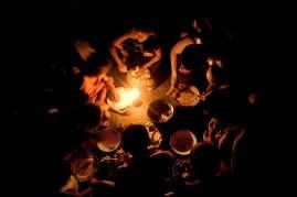 28. A family eats dinner in the slum area near the garbage dump 'Smokey Mountain'.