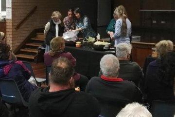 Gillian Kozicki demonstrating how to make sauerkraut