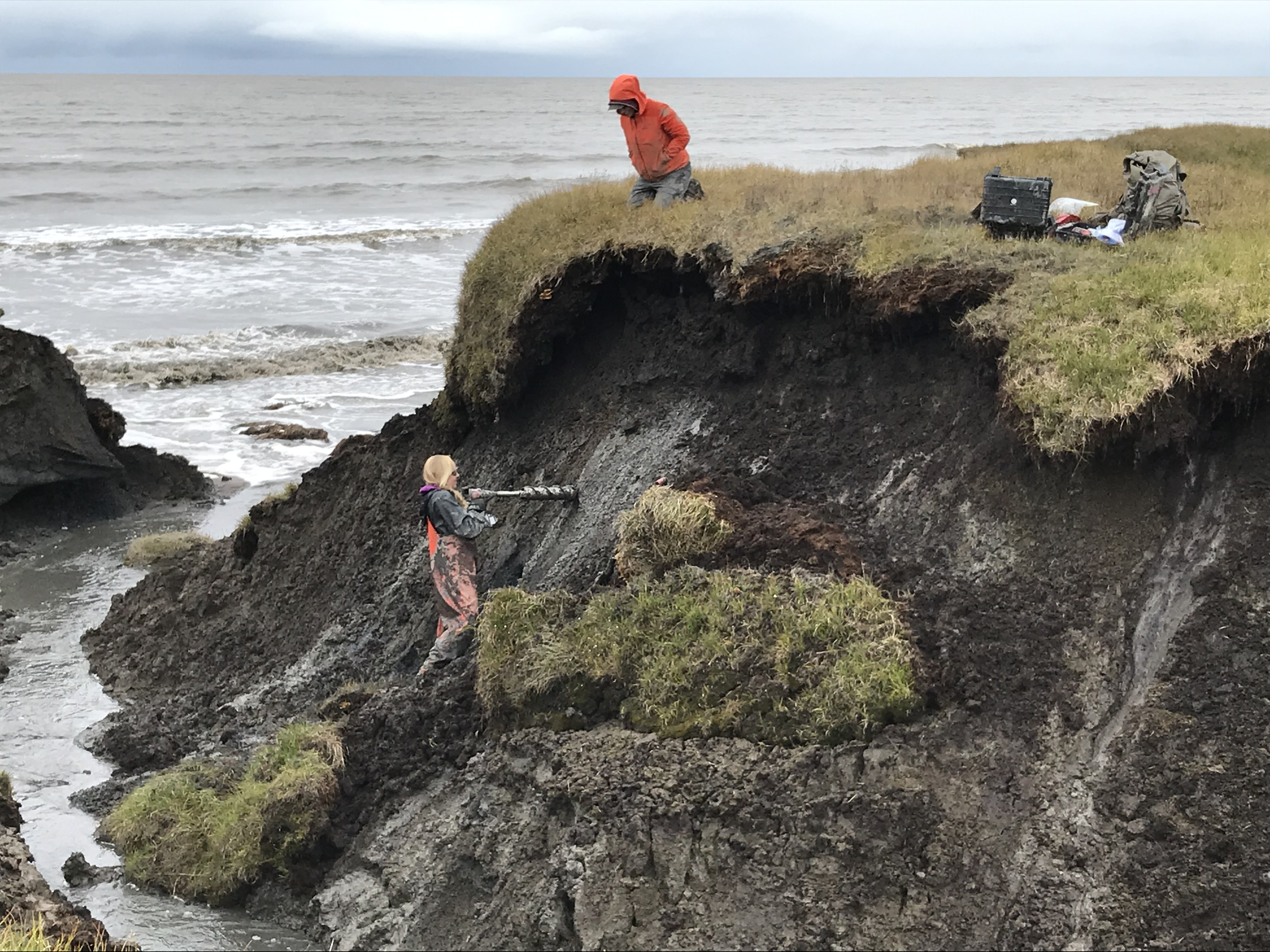 Coring permafrost in a thermo-erosional gully at Drew Point, Alaska.