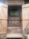 Finished bench seat and outhouse doors