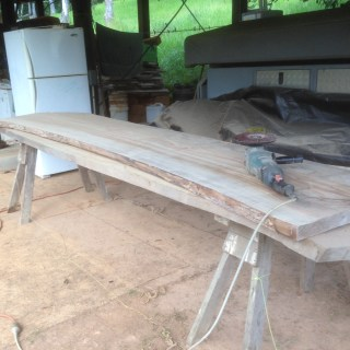 Tom Kendall prepares timbes slabs to make kitchen benchtops at Maungaraeeda.