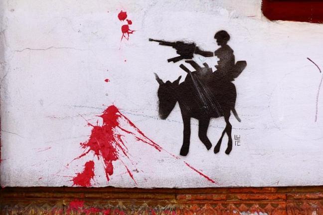 Graffiti na murze w Bogocie.