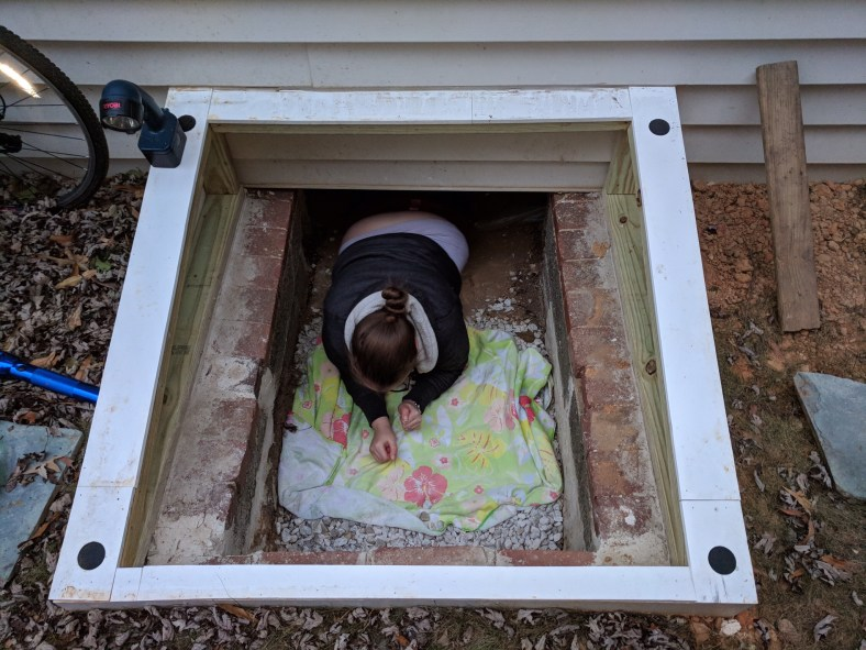 My wife victoriously emerging from the crawl space.