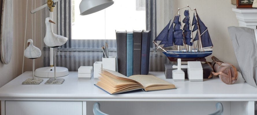Utah home builder white table with wooden chair books and lamp in modern working area at home