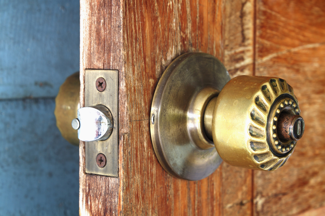 Utah home builder metal handle on a wooden door