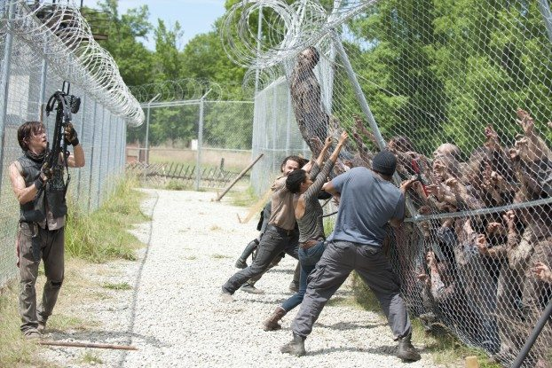 The survivors try to hold back a collapsing fence