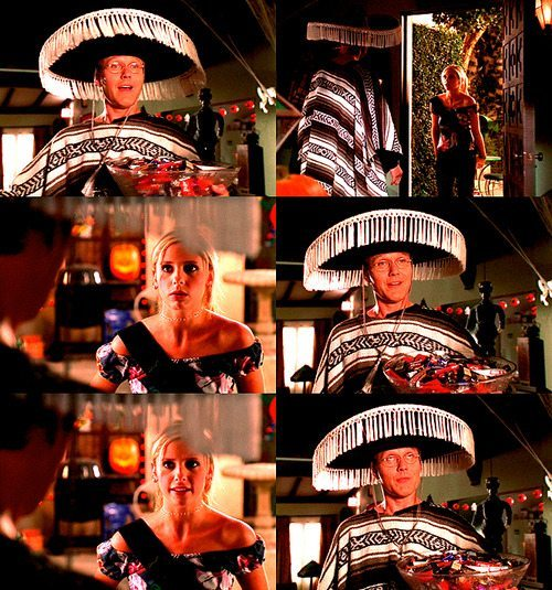 Giles celebrates Halloween in a sombrero and poncho.