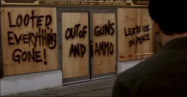 "Graffiti on the doors in St. Alice ""Out of guns and ammo"""