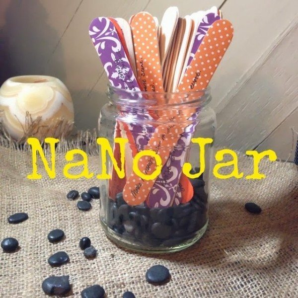"A picture of a glass jar filled with colorful popsicle sticks, captioned ""Nano Jar"""