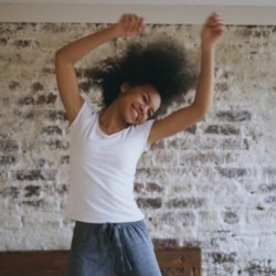 Girl dancing for the joy of the Lord