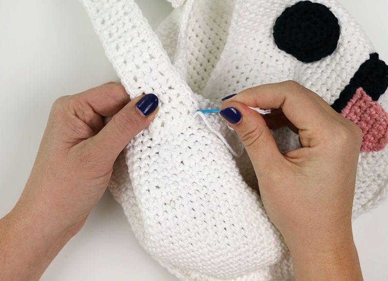 sew handle onto ghost crochet bag