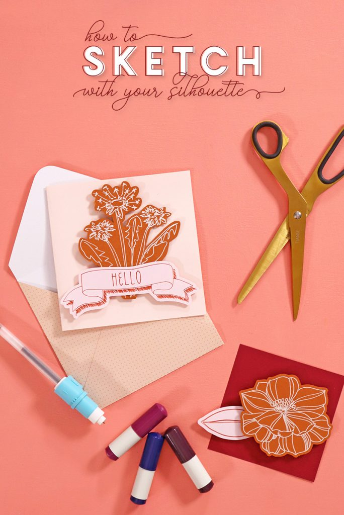 """Blush pink note card with burnt orange floral design element on the front of the card in front of a light pink polka dotted envelope. The notecard is surrounded by a pair of gold scissors, Silhouette sketch pens, a gel pen in a Silhouette pen adapter, and a piece of dark red paper with a burnt orange floral design on it. All of these items are arranged on a coral background. Text at the top of the image reads, """"How to Sketch with your Silhouette."""""""