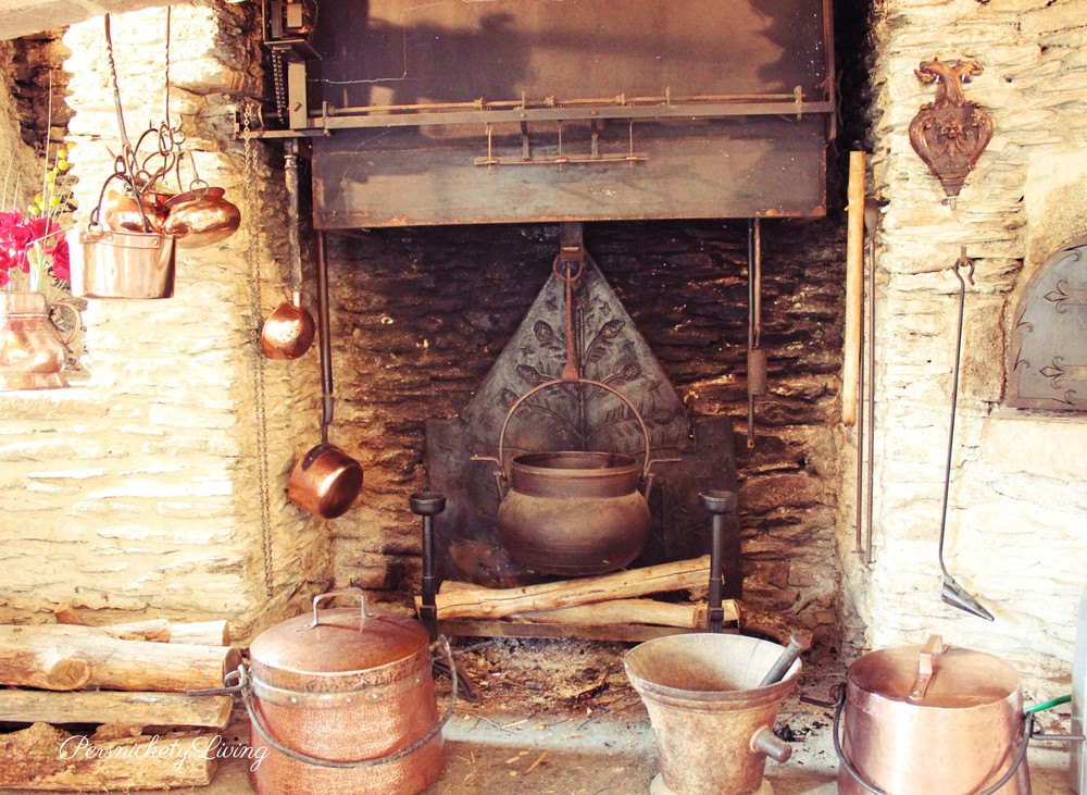 cooking fireplace with copper pots
