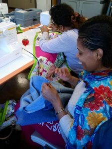 A woman in the refugee sewing class