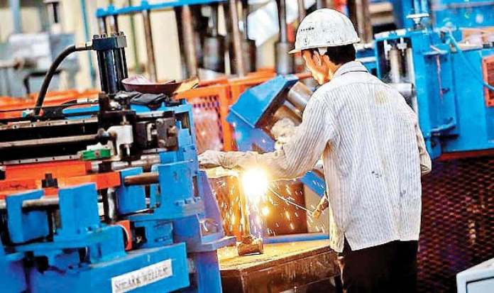 A person working in a factory | New definition of MSMEs
