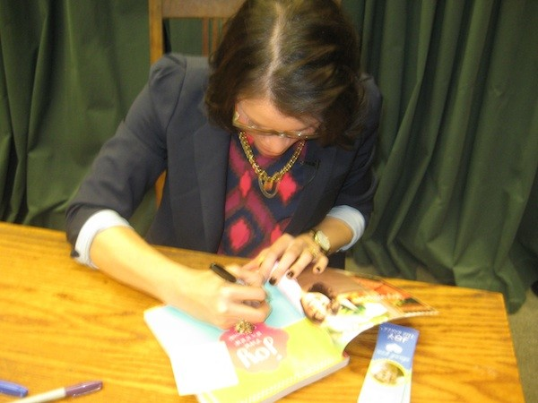 Signing the give-away copy