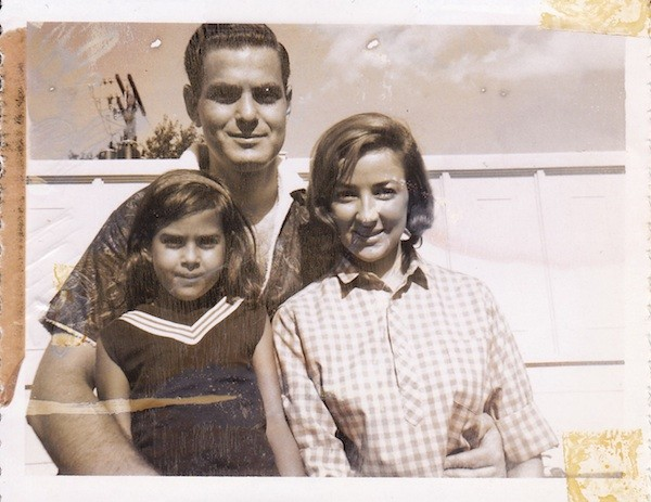 With my parents when I was six