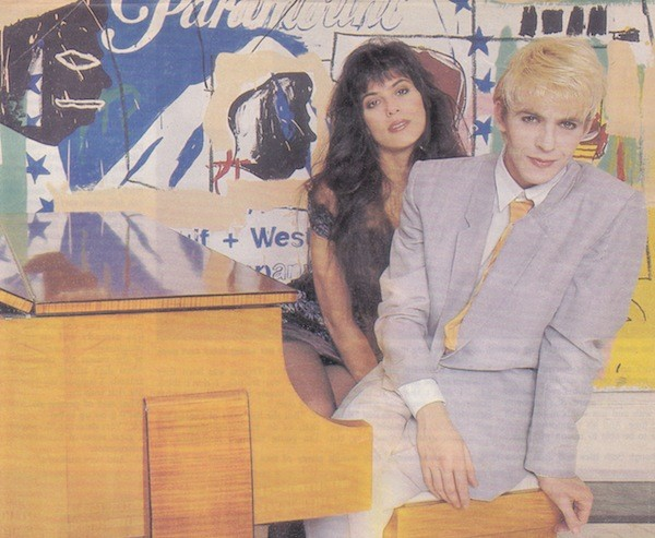 Julie Anne and Nick Rhodes  at home in front of a Warhol-Bsquiat collaboration