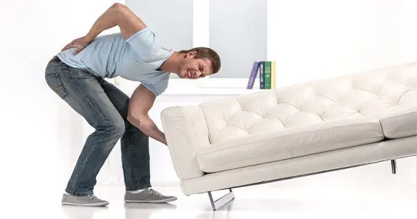 blog picture of man lifting couch with low back pain